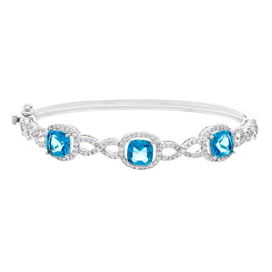 Imagen de BRASS RHODIUM BLUE TOPAZ CROSSOVER DESIGN BANGLE